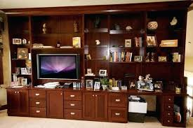 custom built bookcases in cherry lumber with shaker styled doors and glass shelves bookshelves around windows