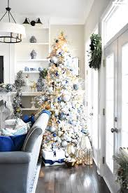 Beautiful, flocked Christmas tree adorned with navy, light blue and elegant  metallics, is