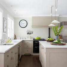 light taupe kitchen with black stove