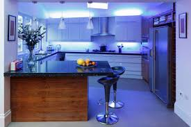 3 pendant lamps over island and under cabinet lighting also blue led strip light for kitchen light fixture