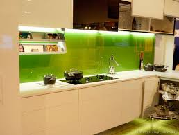 kitchen glass backsplash. #Kitchen Of The Day: Modern Creamy-white Cabinets With A Solid Green Back-painted Glass Backsplash {4th Photo Down On Page} (Kitchen -Design-Ideas.org) Kitchen S