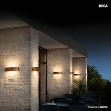 stone tile walls with bega lighting wall lighting and wicker outdoor dining set also garden design