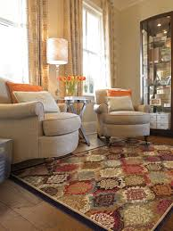 colorful patterned area rug two tan chairs living room