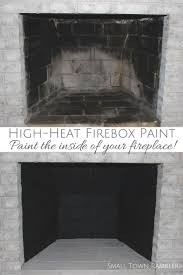 Painting a firebox with high-heat paint.