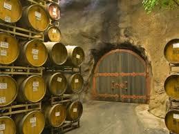 stacked oak barrels. Oak Barrels Stacked Outside Of Door At Ironstone Winery, Calaveras County, California, USA