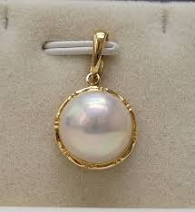 14kt yellow gold pendant with 12 mm japanese akoya mabe pearls