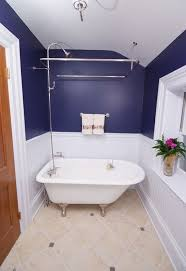 tiny white tub and compact shower unit view