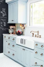 light blue kitchen cabinets gold hardware