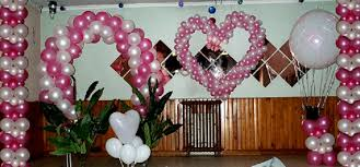 gorgeous pink balloon shape heart closed green plant on nice floor under lighting on simple ceiling