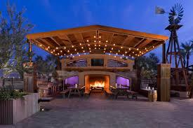 Outdoor pergola lighting ideas White Modern Outdoor Dining Area With Wood Pergola Picnic Tables And Fireplace Hgtvcom Dreamy Pergola Lighting Ideas Hgtv