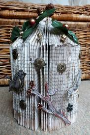 folded a book into a bird cage shape and decorated with chipboard s maya rd and metal ons silk leaves etc i wanted it to have a tatty look