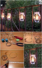20 hang these mason jar luminaries on the railing