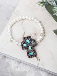 bracelets southern junkie ornate turquoise stone cross pendant on pearl and clear beaded stretch bracelet