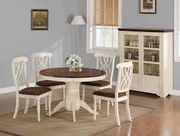 round brown wooden table with white wooden frame and legs feat white wooden chairs with bars