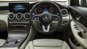 Flamboyant, flowing shapes wrap around the interior. 2019 Mercedes Benz Glc 220d First Drive Review Cartrade