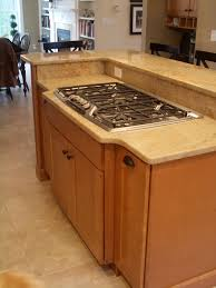 Travertine Floor Kitchen Maple Kitchen Cabinets Stainless Steel Cooktop Granite
