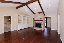 track options recessed lighting for vaulted ceilings brick fireplace cabinet white wooden floor brown electric installation