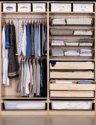 Ikea Closet Idea With White Storage Compartments And Floor To Ceiling Shelfs