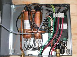 mounting tankless water heater mount the unit upright in a secure dry position on an accessible wall