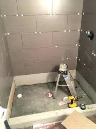 installing wall tile in a shower tile shower installation installing tile shower walls tile installation shower wall installing large wall tile in shower
