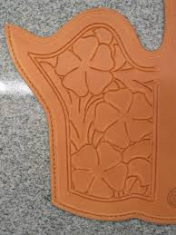 edge pattern used on both the holster and the belt when the edge stamping is done bend the damp leather into the shape it will be around the holster