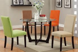 modern dining room design with ikea round gl top dining table colorful fabric dining chairs