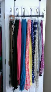 Use an over-the-door coat rack and shower curtain rings to hang and