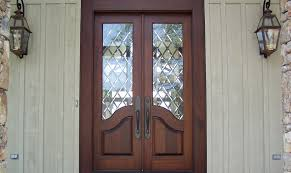 awesome beveled glass entry doors with mahogany material and trellis glass door featuring 2 pillars natural stone and wall sconces