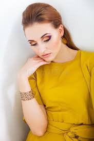 beautiful with make up wearing long yellow dress stock image image of gold