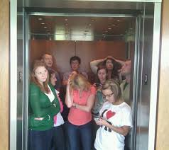 people talking in elevator. blastmedia team national talk in an elevator day 2 people talking t
