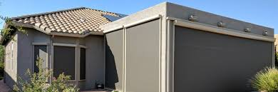 gray house with sun screens
