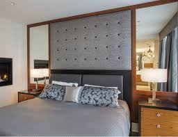 hollywood style symmetrical mirrors with a fabric headboard