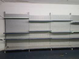 used hd metal gondola shelving 54 sections with approx 4 shelves per