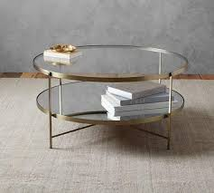 two tiered brass framed glass round