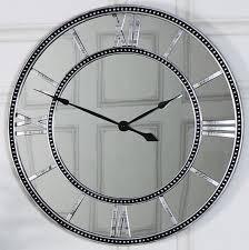 silver mirrored skeleton wall clock