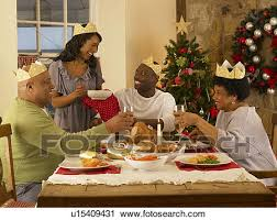Includes turkey or ham, potatoes and pie. Adult African American Family Having Christmas Dinner Stock Image U15409431 Fotosearch