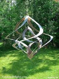 spinning yard art kinetic wind sculpture incorporates a beautiful use of sculptured metal pieces which spin