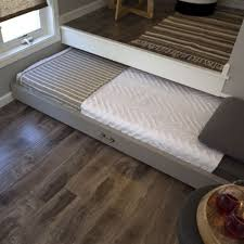 A pull out bed helps create a sleep space when you need it, but also doesn&  take up any additional sqaure footage in your tiny house!