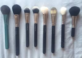 mac face brushes. first is the mac 127 split fibre face brush. mine has a blue handle because this brush came out with alluring aquatic collection. mac brushes 5