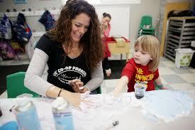 Teacher Bonnie Toth helps Sawyer Karadbil, 3, play with shaving ...