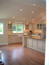 lighting for slanted ceilings. vaulted kitchen ceiling with transom window above sink lighting for slanted ceilings