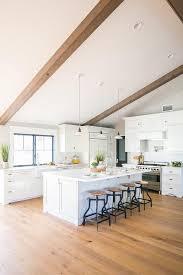 white vintage barn lights over kitchen
