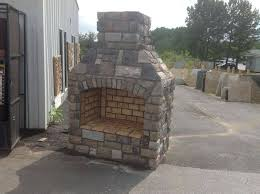 outdoor fireplace paver patio: outdoor fireplace made out of concrete blocks stone and brick pavers