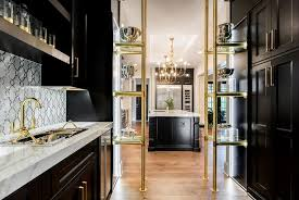black and gold butler pantry with brass and glass shelves
