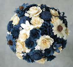navy blue and ivory wedding bouquets and boutonnieres made of birch wood and sola wood flowers