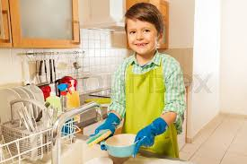 boys washing dishes. Exellent Boys Lifestyle Portrait Of A Boy Washing Dishes In The Kitchen Sink Smiling To  Camera And Holding Mop With Soap  Stock Photo Colourbox To Boys Washing Dishes I