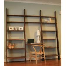 large brown wooden wall leaning ladder wall shelf complete with desk and chair