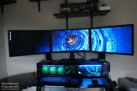 three monitor computer station set up with custom built cpu underneath
