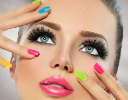 beauty face with colorful nail polish manicure and makeup stock photo 54898657