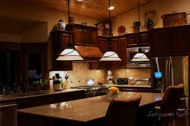amazing l shape kitchen decoration with glass flare lamp shade granite counter top and dark brown solid wood kitchen cabinet brown solid wood shape home